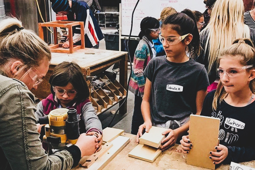Group of architecture students with Girl Scouts as they visited the School of Architecture in spring 2019.