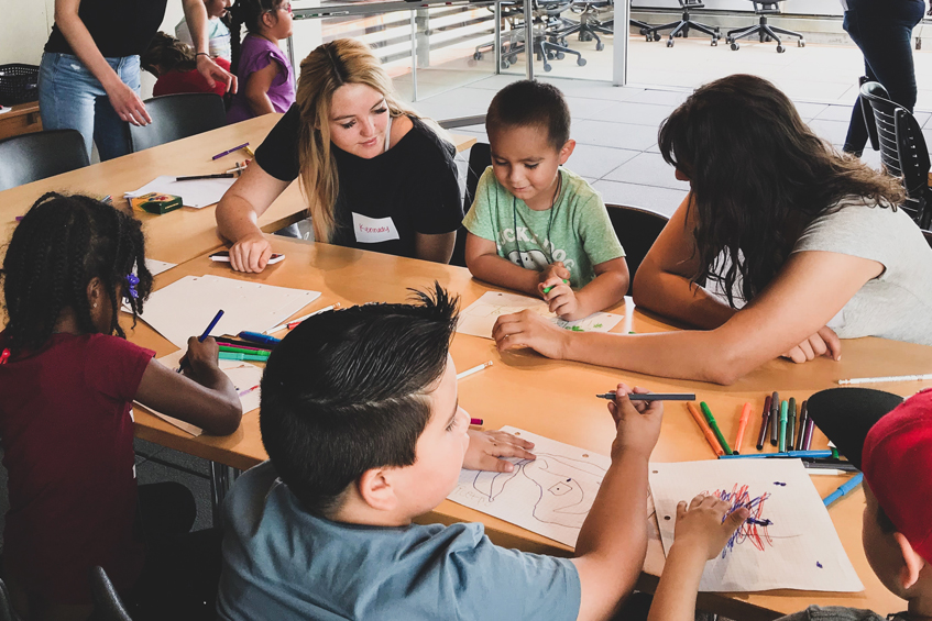 Students from a local elementary school visited the School of Architecture to see what architects do. Here, WIAS members work with students so they can learn about these opportunities.