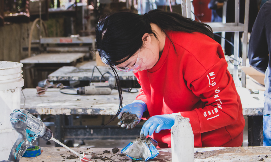 A student using concrete in the concrete lab at the college of architecture, planning and landscape architecture