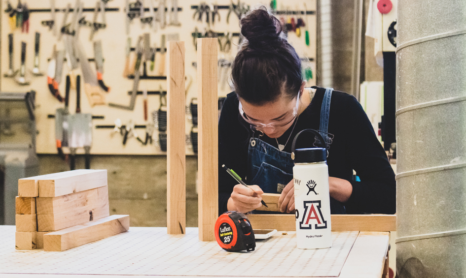 A photo of a student in the wood lab at the college of architecture, planning and landscape architecture