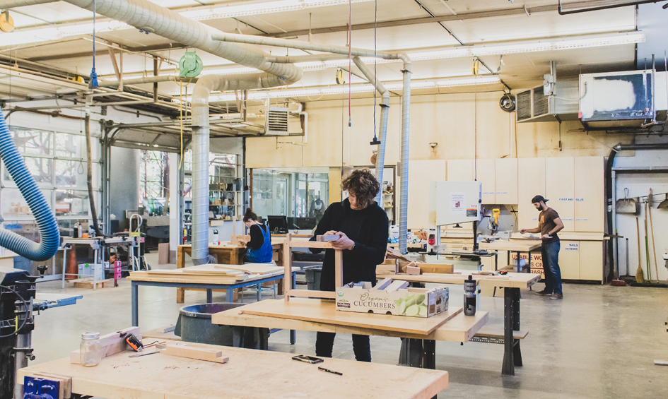 CAPLA students working with wood in the wood lab in the materials lab at the college of architecture, planning and landscape architecture