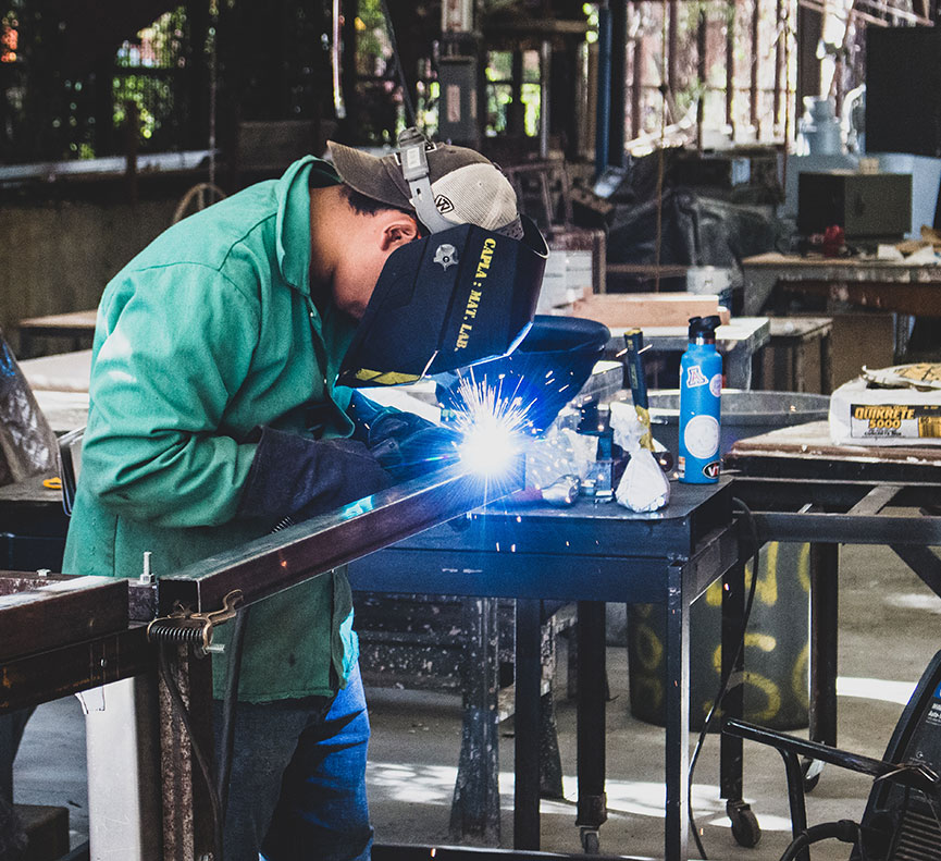 Student welding in the Materials Lab