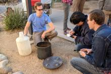 Students conduct a soil percolation test