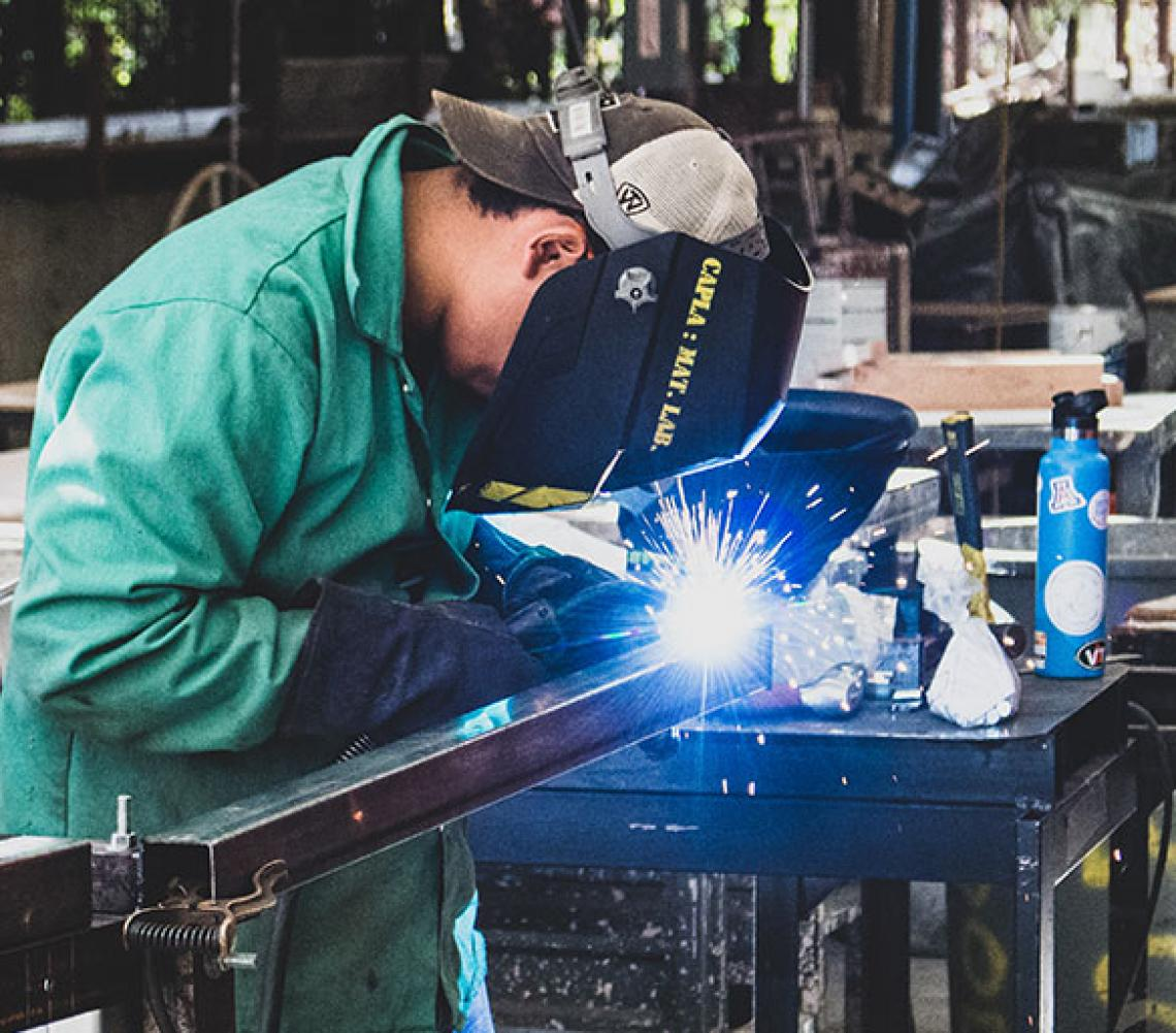 Architecture student welding in Materials Lab.
