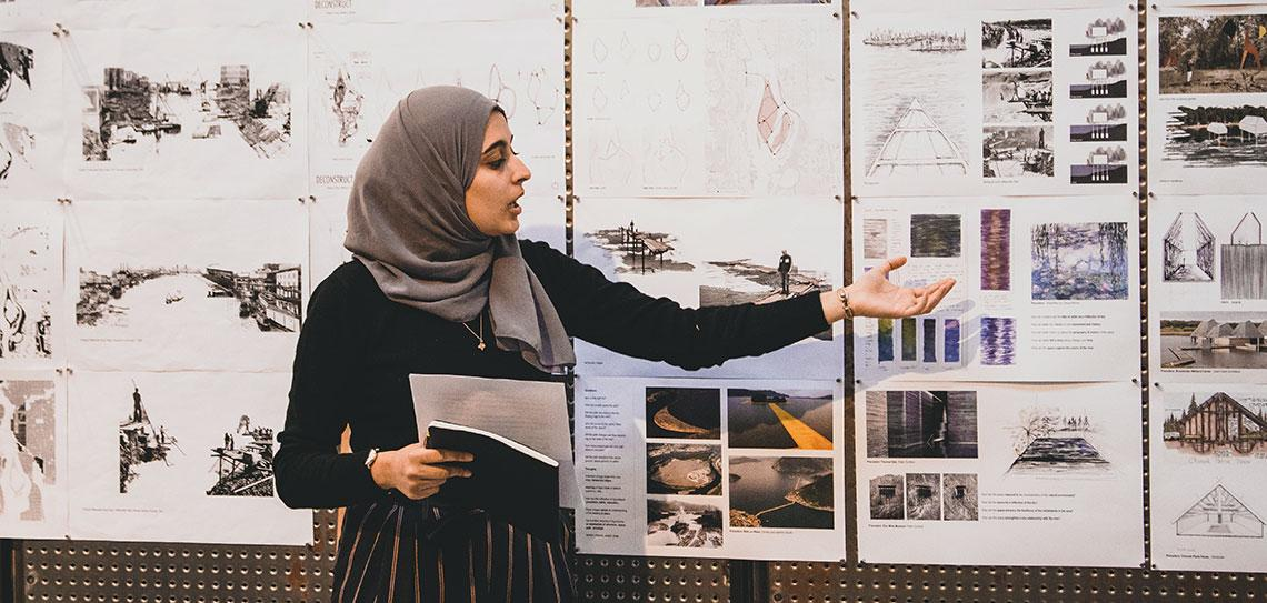Architecture student presenting during review