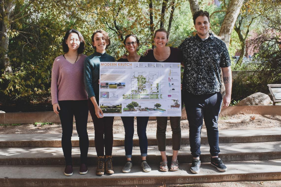 Students stand in the Underwood garden with project poster.