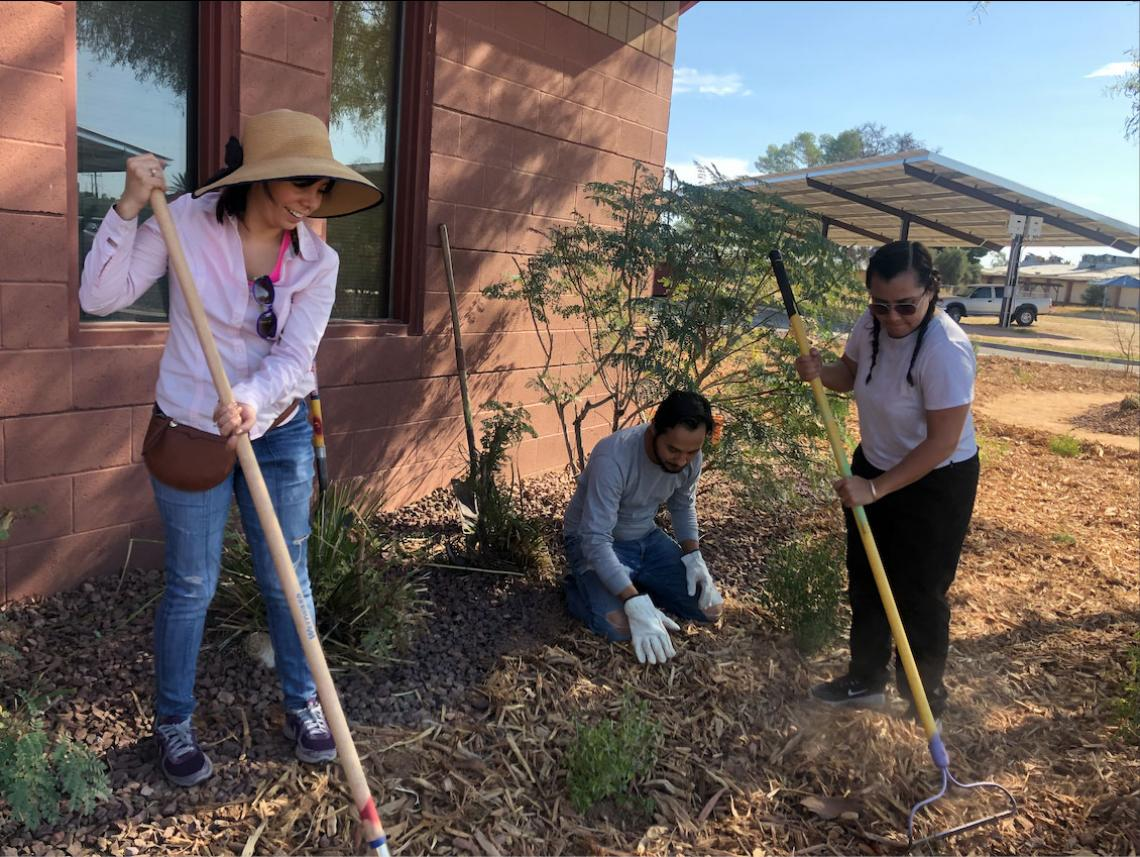 UA students install green infrastructure alongside Star Academic High School students.