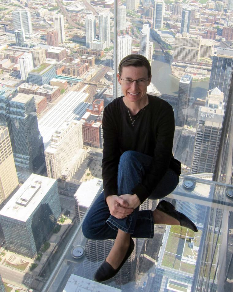 Lisa Schrenk in observation deck with glass floor over Chicago